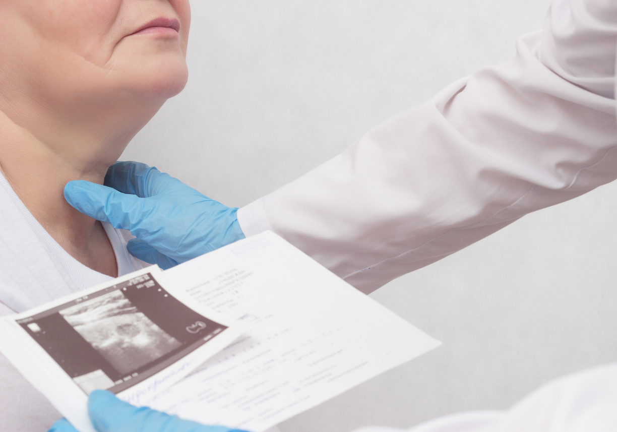 A woman is on reception at the endocrinologist, the doctor looks at the results of an ultrasound scan of the thyroid gland, close-up, medic